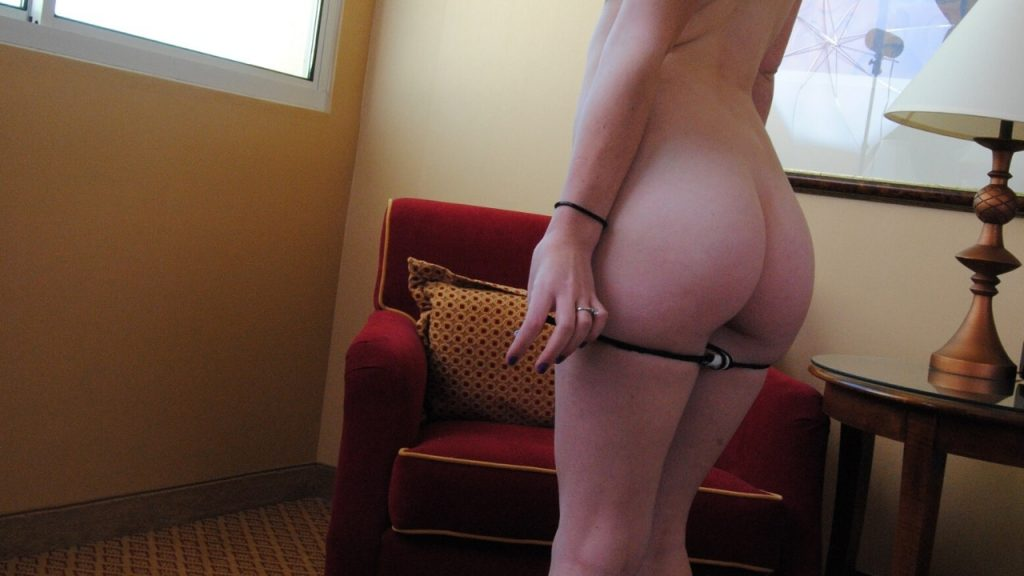 wife taking off her thong in hotel room