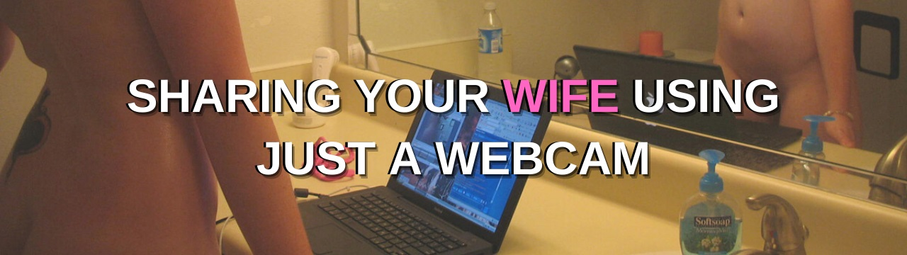 woman using webcam on laptop in bathroom