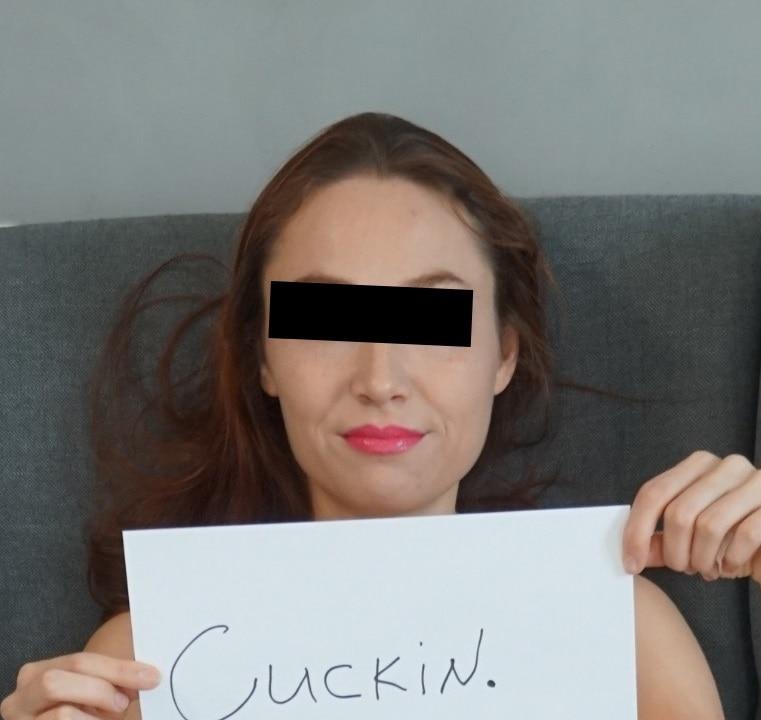 queen femdom holding a cuckin sign