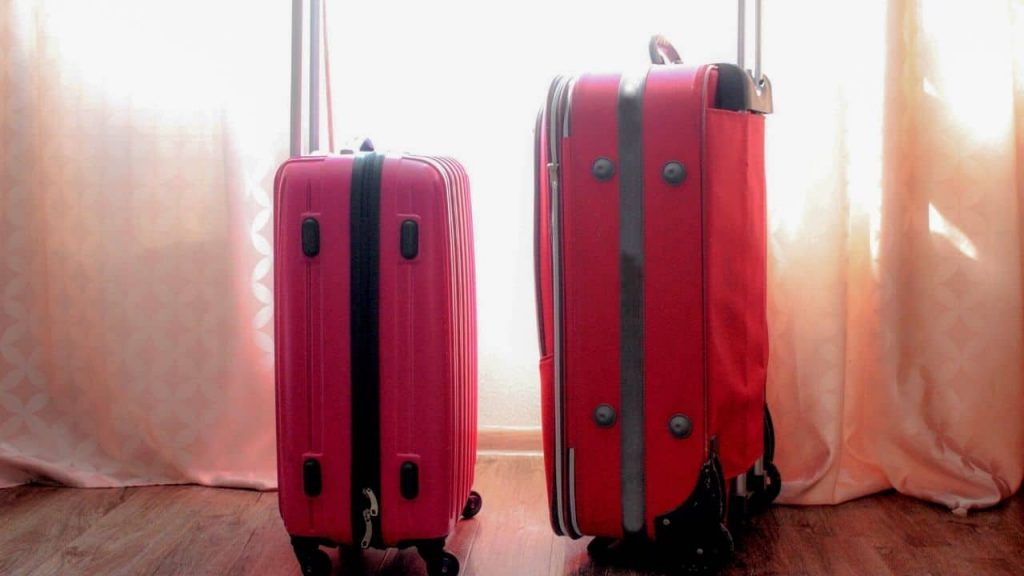 two pink suitcases