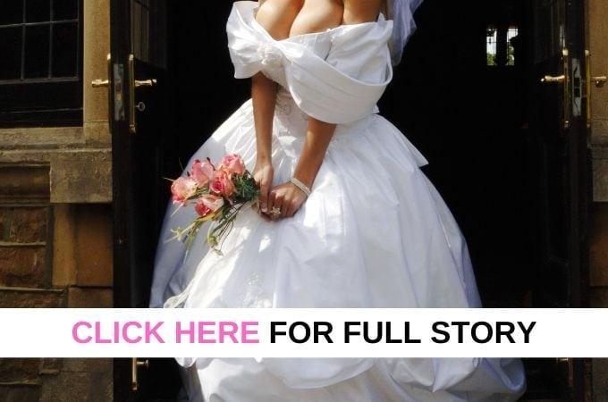 woman in wedding dress standing in doorway